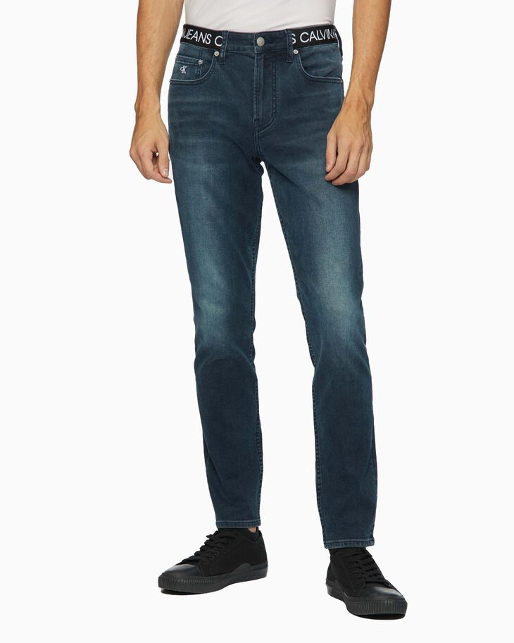 CALVIN KLEIN CKJ 017 INFINITE FLEX BODY SKINNY JEANS WITH LOGO TAPE