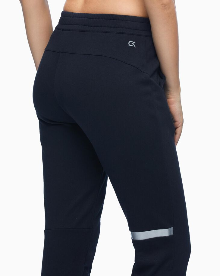 CALVIN KLEIN SUSTAINABLE REFLECTIVE LOGO CROPPED SWEAT PANTS