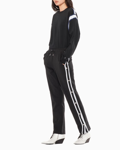 CALVIN KLEIN POPPER TAPE TRACK PANTS
