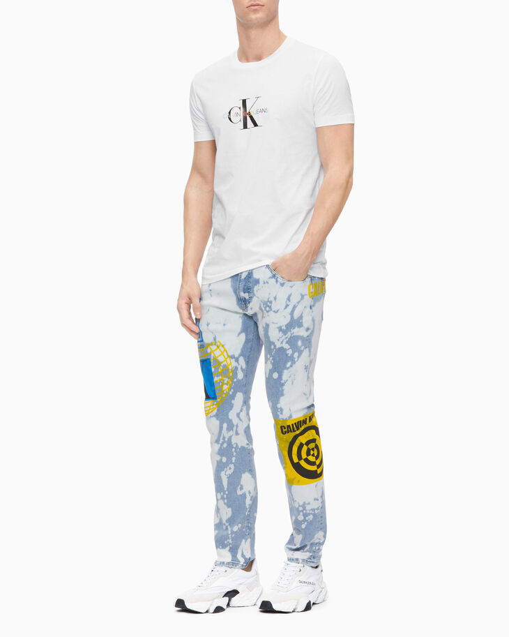 CALVIN KLEIN CKJ 056 37.5 BLEACHED GRAFFITI ATHLETIC TAPER JEANS