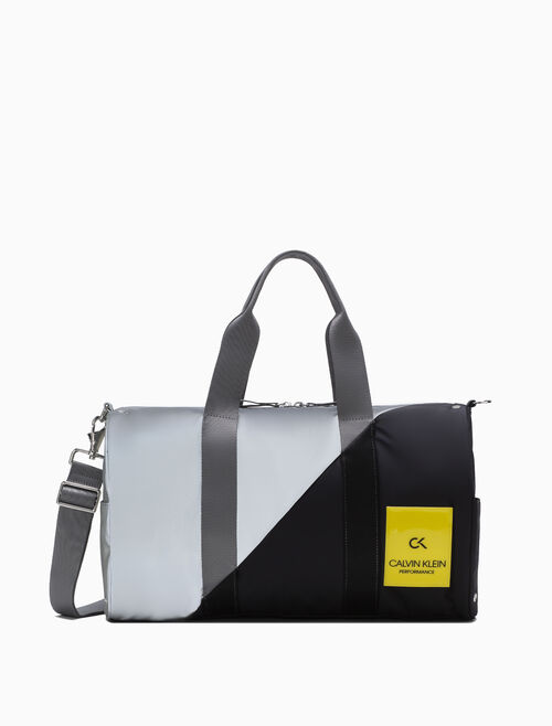 CALVIN KLEIN SLICED CAPSULE SMALL DUFFLE BAG