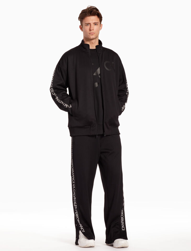 CALVIN KLEIN RE-EMERGE TEARAWAY TRACKPANTS