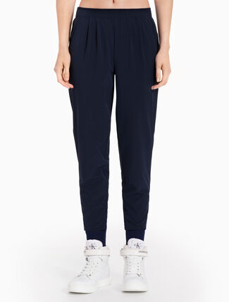 CALVIN KLEIN WOVEN PANTS WITH LOGO WAISTBAND