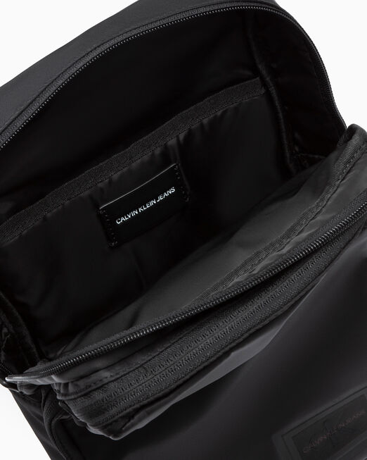CALVIN KLEIN SLEEK NYLON MULTI-POCKET SLING BAG