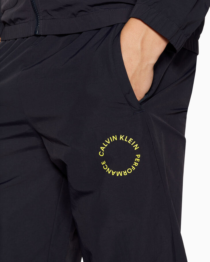 CALVIN KLEIN SPACE LINES TRACK PANTS