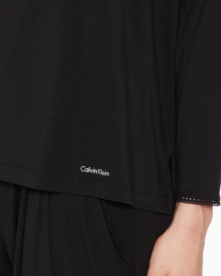 CALVIN KLEIN SENSUAL TOUCH ロングスリーブ T シャツ
