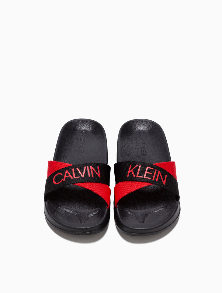 CALVIN KLEIN WOVEN STRAP SLIDES