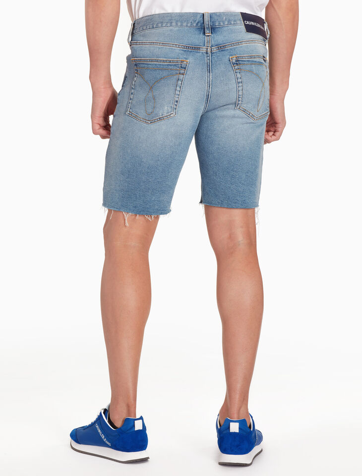 CALVIN KLEIN FRAYED SLIM DENIM SHORTS
