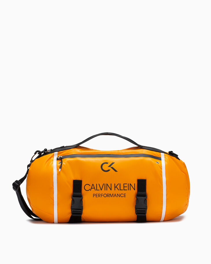 CALVIN KLEIN CIRCLED SLING BARREL BAG