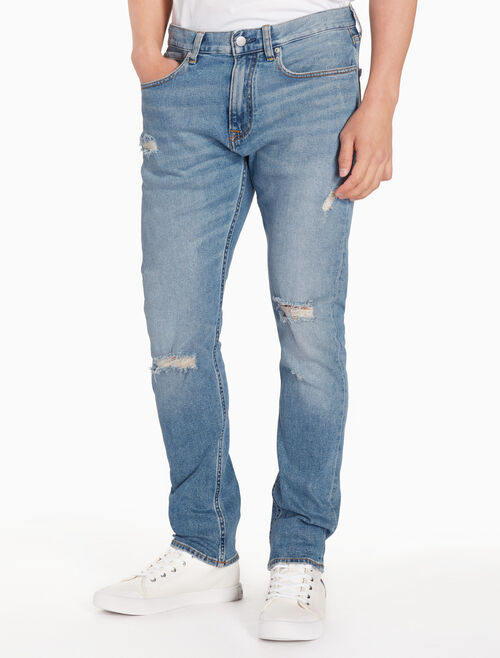 CALVIN KLEIN CKJ 056 MEN DISTRESSED ATHLETIC TAPER JEANS