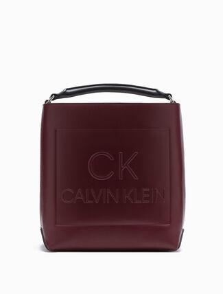 CALVIN KLEIN EMBOSSED LOGO BUCKET BAG