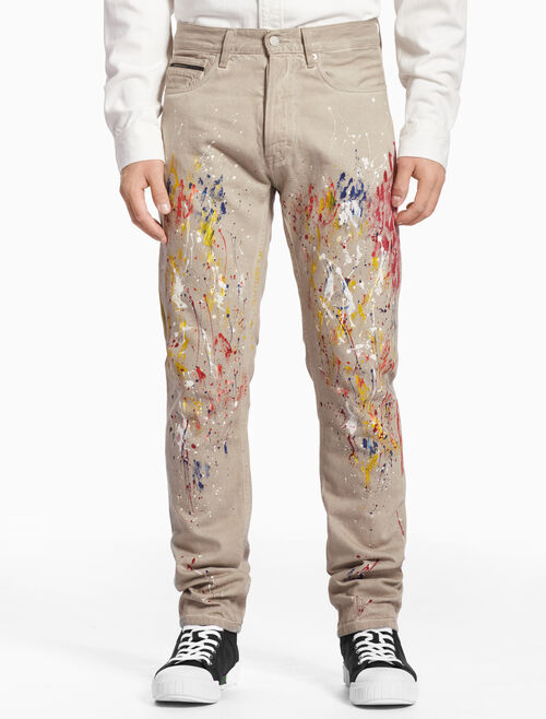 CALVIN KLEIN SLIM TWILL PANTS WITH PAINT SPLATTER