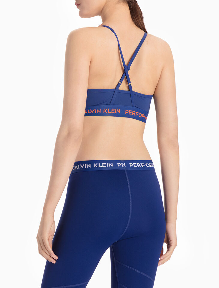 CALVIN KLEIN DUAL-TONED SPORTS BRA TOP